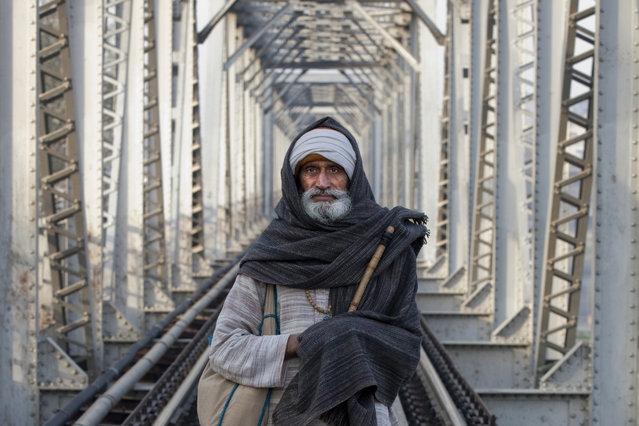 """Trestle Traveler"". Image captured on the train trestle across the Yamuna river in Mathura. Photo location: Mathura, India. (Photo and caption by Greg Davis/National Geographic Photo Contest)"