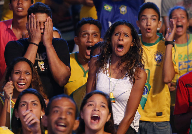 Brazilian soccer fans react while watching the opening soccer match Brazil against Croatia in a fan zone during the 2014 World Cup in Recife June 12, 2014. (Photo by Yves Herman/Reuters)