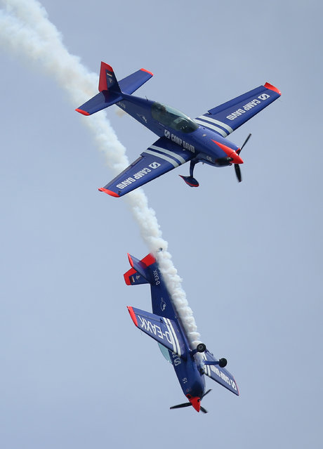 Two Extra 300 aerobatic planes fly at the ILA 2014 Berlin Air Show on May 21, 2014 in Schoenefeld, Germany. (Photo by Sean Gallup/Getty Images)