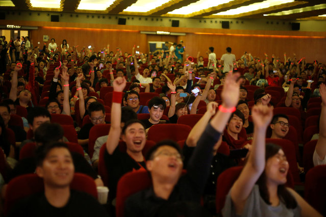 """Fans react during China's premiere of the film """"Warcraft"""" at a theatre in Shanghai, China June 7, 2016. (Photo by Aly Song/Reuters)"""