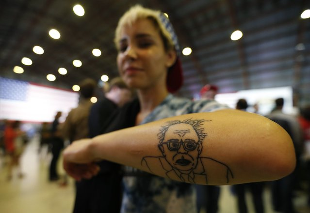 A supporter shows off a tattoo as she awaits an appearance by Democratic U.S. presidential candidate Bernie Sanders following the closing of the polls in the California presidential primary in Santa Monica, California, U.S., June 7, 2016. (Photo by Mario Anzuoni/Reuters)