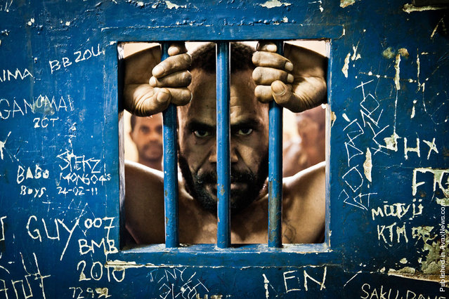 Andres Sime (39), is waiting for the court trial in the prison cell having been accused of multiple rapes. Port Morsby, the Boroko police station