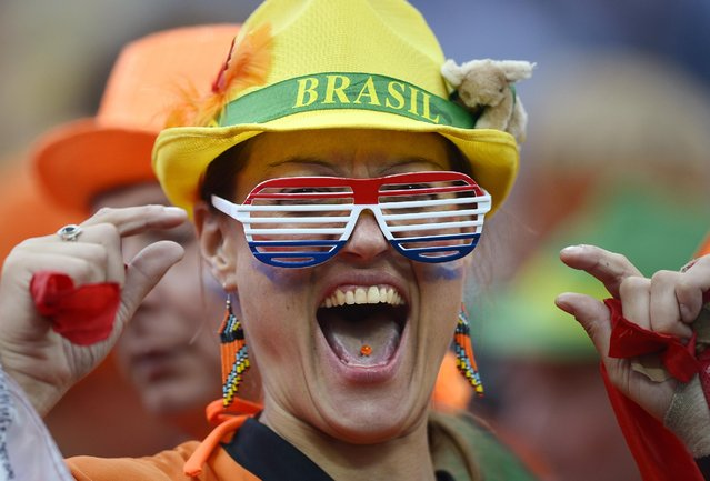 A Dutch supporter reacts before the World Cup semifinal soccer match between the Netherlands and Argentina at the Itaquerao Stadium in Sao Paulo Brazil, Wednesday, July 9, 2014. (Photo by Manu Fernandez/AP Photo)