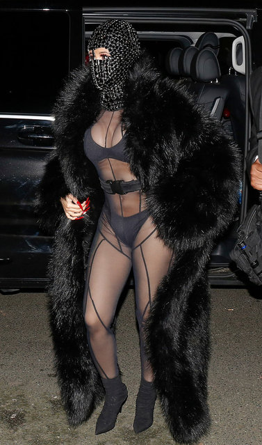 Cardi B supports husband Offset at the launch of his line with Laundered Works Corp., clad in a see-through catsuit, faux fur coat and bedazzled ski mask during AW20 Paris Fashion Week Men's on January 16, 2020 in Paris, France. (Photo by The Mega Agency)