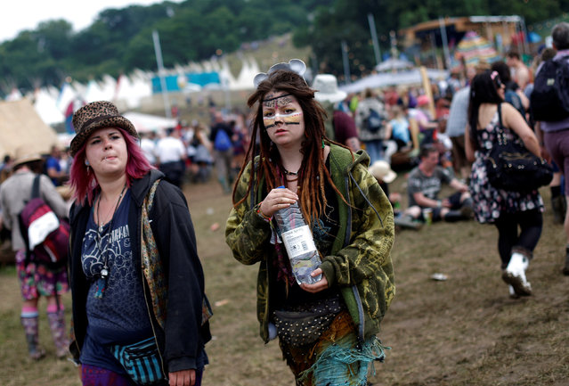 Revellers look on during the Glastonbury Festival at Worthy Farm in Somerset, Britain, June 23, 2016. (Photo by Stoyan Nenov/Reuters)