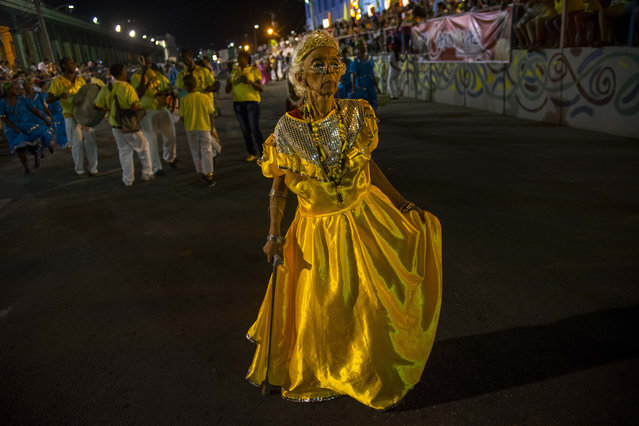 In this July 25, 2015 photo, Isabel Almenares, 78, parades in costume during carnival celebrations in Santiago, Cuba. Those who do reach Santiago find a city rich with history but hampered by what visitors and residents alike call substandard accomodations, few high-quality restaurants and a lack of fun things to do at night. (Photo by Ramon Espinosa/AP Photo)
