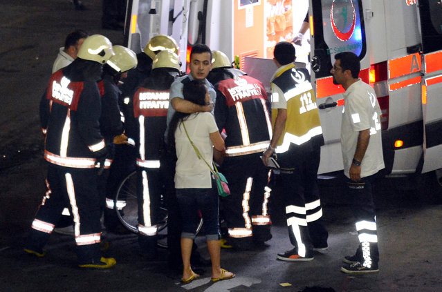 Paramedics help injured outside Turkey's largest airport, Istanbul Ataturk, Turkey, following a blast June 28, 2016. (Photo by Ismail Coskun/Reuters/IHLAS News Agency)