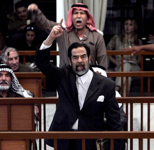 Former Iraqi President Saddam Hussein and Barzan Ibrahim al-Tikriti berate the court during their trial in Baghdad, Monday Dec. 5, 2005
