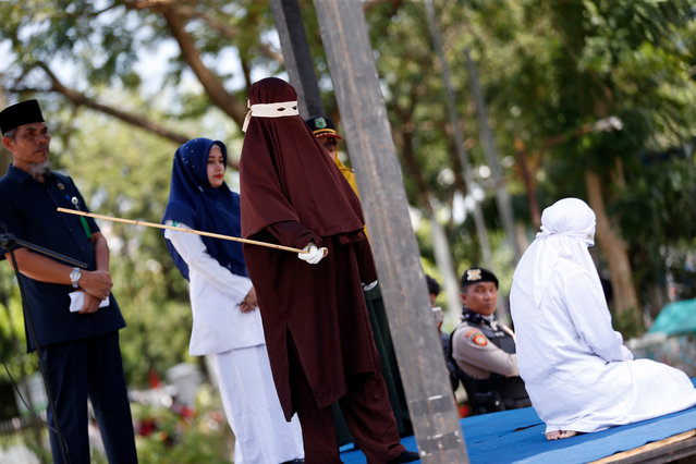 A Female Sharia police officer canes an Acehnese woman for having s*x outside of marriage in Banda Aceh, Aceh, Indonesia, 02 March 2020. Eight people were subjected to punishment ranging from 25 to 45 lashes for breaking the Sharia law in Aceh. Aceh is the only province in Indonesia that has implemented Sharia law and considers lesbian, gay, bisexual relationships and s*x outside of marriage as violations of the code of religious law. (Photo by Hotli Simanjuntak/EPA/EFE)