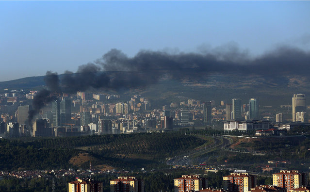 Smoke billows from an area near the presidential palace, right, in Ankara, Turkey, Saturday, July 16, 2016. (Photo by Ali Unal/AP Photo)