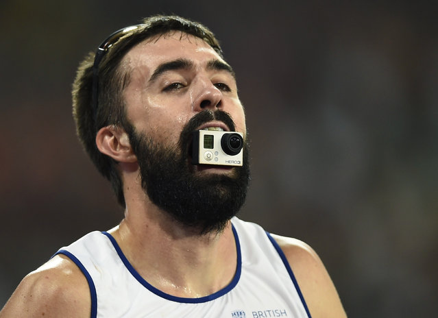Martyn Rooney of Britain holds a GoPro camera in his mouth after finishing third in the men's 4 x 400 metres relay final at the 15th IAAF Championships at the National Stadium in Beijing, China August 30, 2015. (Photo by Dylan Martinez/Reuters)