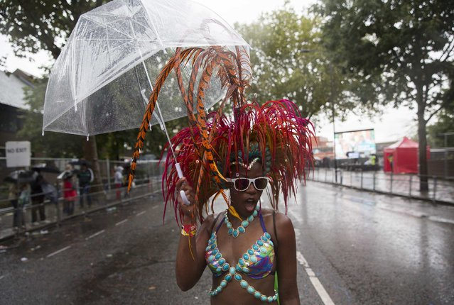 A performer poses as she takes part in the Notting Hill Carnival in west London August 25, 2014. (Photo by Neil Hall/Reuters)