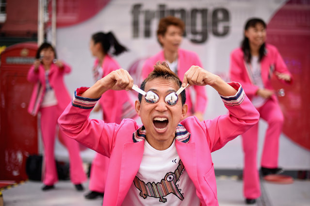 Sushi Tap Show perform in the Edinburgh Festival Fringe on the Royal Mile on August 14, 2014 in Edinburgh, Scotland. The largest performing arts festival in the world, this year's festival hosts more than 3,000 shows in nearly 300 venues across the city. (Photo by Jeff J. Mitchell/Getty Images)