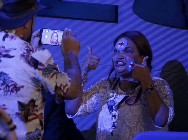 A delegate with Hillary Clinton stickers on her face sits for a video at the Democratic National Convention in Philadelphia, Pennsylvania, U.S. July 27, 2016. (Photo by Gary Cameron/Reuters)