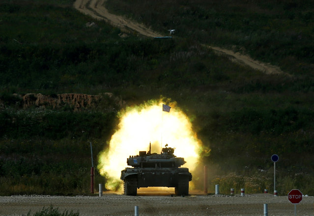 A T-72 tank, operated by a crew from Kazakhstan, fires at a target during the Tank Biathlon competition, part of the International Army Games 2016, at a range in the settlement of Alabino outside Moscow, Russia, August 2, 2016. (Photo by Maxim Shemetov/Reuters)