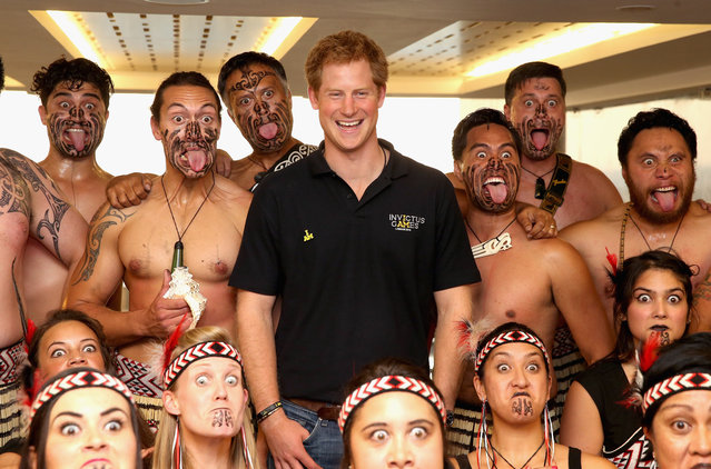 "Prince Harry poses with Ngati Ranana Maori Dancers as he meets the New Zealand Invictus Team at New Zealand House on September 8, 2014 in London, England. The International sports event for ""wounded warriors"", presented by Jaguar Land Rover, is just days away with limited last-minute tickets available at www.invictusgames.org. (Photo by Chris Jackson/Getty Images)"