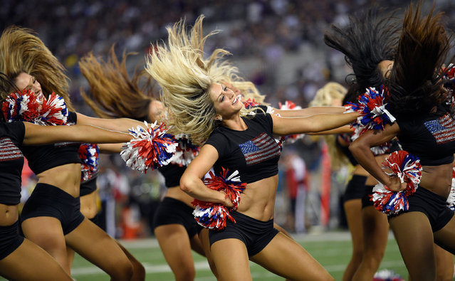 The Baltimore Ravens cheerleaders perform during the first half of an NFL football game against the Pittsburgh Steelers Thursday, September 11, 2014, in Baltimore. (Photo by Nick Wass/AP Photo)
