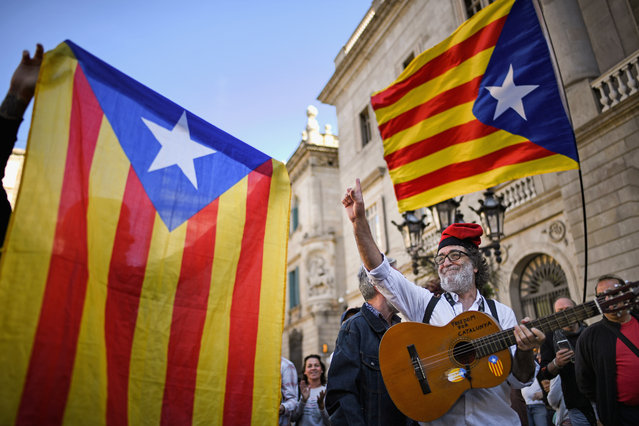 Independence supporters gather outside the Palau Catalan Regional Government Building as Catalonia returns to work following last week's decision by the Catalan parliament to vote to split from Spain on October 30, 2017 in Barcelona, Spain. The Spanish government has responded by imposing direct rule and dissolving the Catalan parliament. (Photo by Jeff J Mitchell/Getty Images)