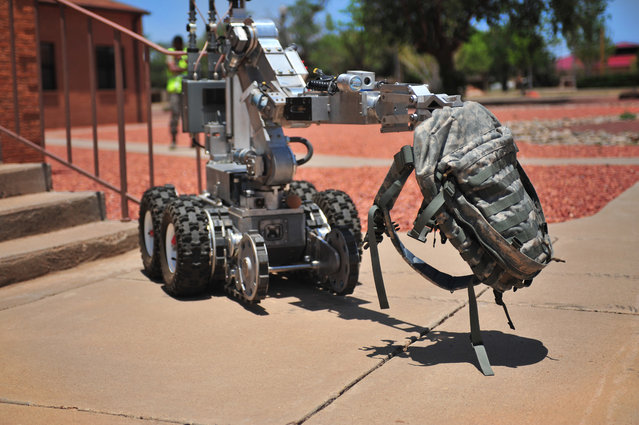 The Andros F6A robot, controlled by U.S. Air Force Explosive Ordinance Disposal team members, carries a backpack containing an improvised explosive device during a hostile threat exercise at Cannon Air Force Base, N.M., June 20, 2012. Air Commandos responded quickly to maintain control of the situation. (U.S. Air Force photo by Airman 1st Class Eboni Reece)