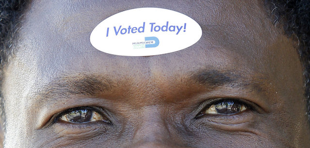 Jean Robert Soutien displays on his forehead the sticker he received after voting during the U.S. presidential election in North Miami Beach, Florida November 6, 2012. (Photo by Andrew Innerarity/Reuters)