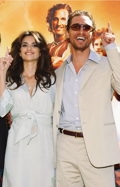 """Actress Penelope Cruz poses with her boyfriend and co-star Matthew McConaughey at the Spanish photocall for their new film """"Sahara"""" at the Hotel Villamagna on April 13, 2005 in Madrid, Spain. (Photo by Carlos Alvarez/Getty Images)"""