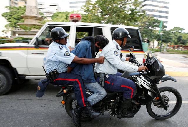 A protester is detained during a rally to demand for a referendum to remove Venezuela's President Nicolas Maduro in Caracas, Venezuela, September 1, 2016. (Photo by Carlos Garcia Rawlins/Reuters)