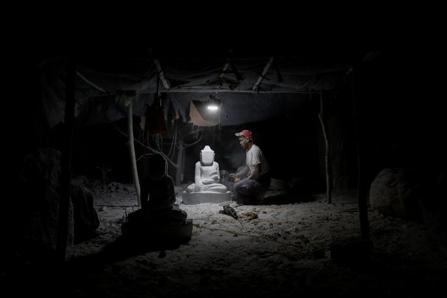 A marble carver works on a statue of a Buddha in his carving workshop in Sagyin village, Mandalay, Myanmar on February 13, 2019. For generations, artisans in this part of Buddhist-majority Myanmar have carved out a living from white marble, fashioning mostly colossal Buddha statues to be sold in the nearby city of Mandalay or exported to neighboring China and Thailand. (Photo by Ann Wang/Reuters)