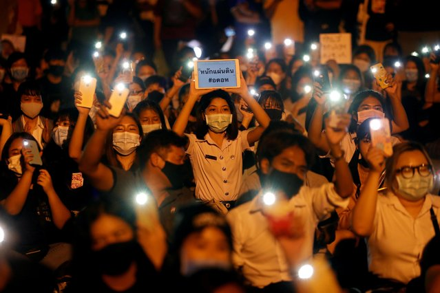 Demonstrators light up their smartphones as they gather during a protest demanding the resignation of Thailand's Prime Minister Prayut Chan-o-cha, under a highway in Pathum Thani, at the outskirts of Bangkok, Thailand, July 23, 2020. (Photo by Jorge Silva/Reuters)