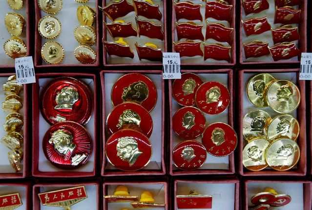Pins bearing images of China's late Chairman Mao Zedong are displayed at a souvenir shop in Beijing, November 25, 2013. (Photo by Kim Kyung-Hoon/Reuters)