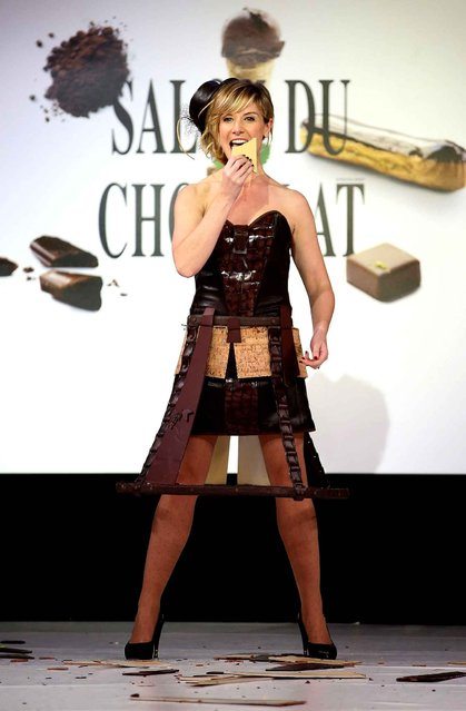 Louise Ekland walks the runway and wears a chocolate costume made by designer and a chocolate maker during the Fashion Chocolate show at Salon du Chocolat at Parc des Expositions Porte de Versailles in Paris, France, October 28, 2014. (Photo by LAURENTVU/SIPA Press)
