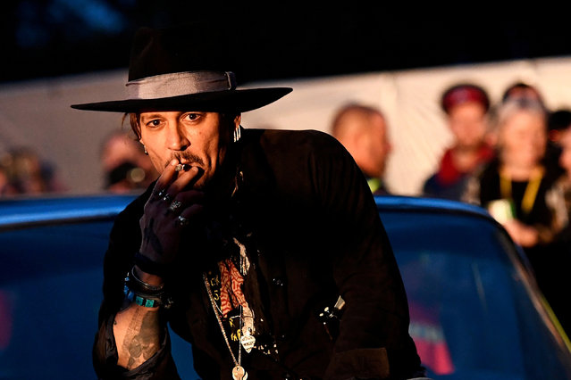 Johnny Depp poses on a Cadillac before presenting his film The Libertine, at Cinemageddon at Worthy Farm in Somerset during the Glastonbury Festival in Britain, June 22, 2017. (Photo by Dylan Martinez/Reuters)