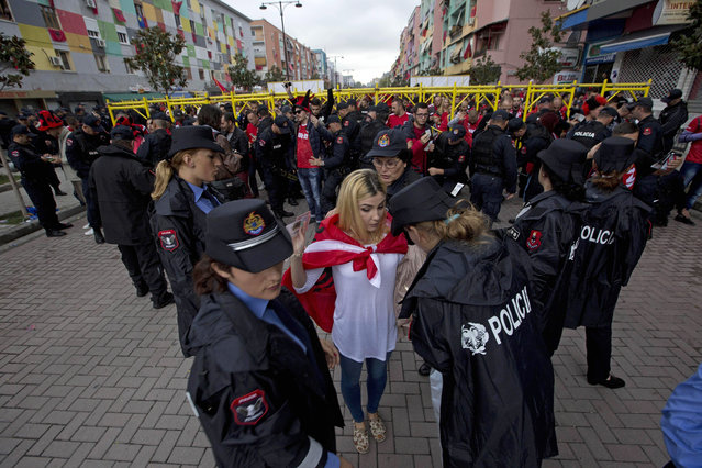 Albania fans wait to be searched by police before the Group I Euro 2016 qualifying match between Albania and Serbia in Elbasan, central Albania, Thursday, October 8, 2015. More than 2,000 officers will police the politically-charged match. (Photo by Visar Kryeziu/AP Photo)