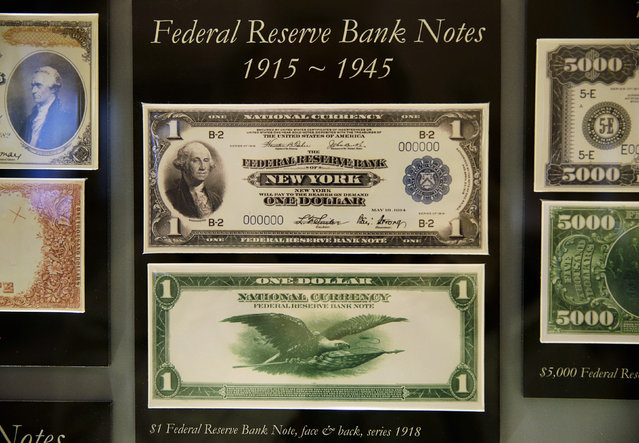 A display case shows 1918 historic United States Federal Reserve one dollar bank notes at the Bureau of Engraving and Printing in Washington November 14, 2014. (Photo by Gary Cameron/Reuters)