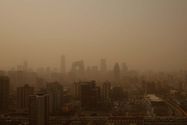 A general view of the skyline in the sandstorm on February 28, 2013 in Beijing, China. Beijing was hit by its first sandstorm of the year while its air quality reached dangerous level on Thursday.  (Photo by Feng Li)