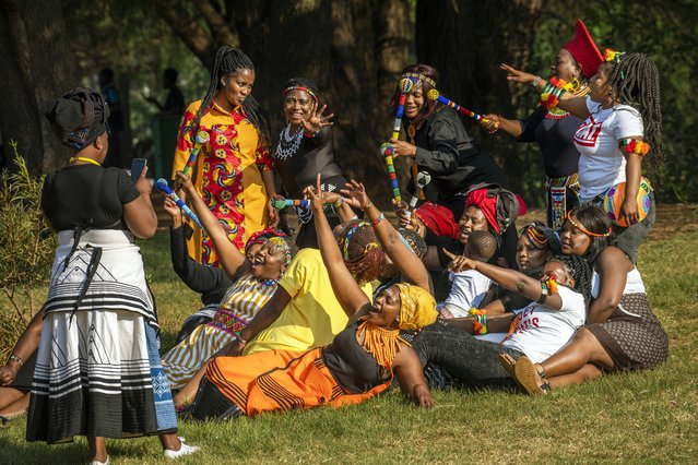 A group of women dressed in traditional clothing pose for a selfie as they celebrate South Africa's Heritage Day at Zoo Lake park in Johannesburg Thursday September 24, 2020. As the number of worldwide Covid-19 death is nearing the million mark, coronavirus related case numbers and deaths in South Africa hit the lowest in months. (Photo by Jerome Delay/AP Photo)