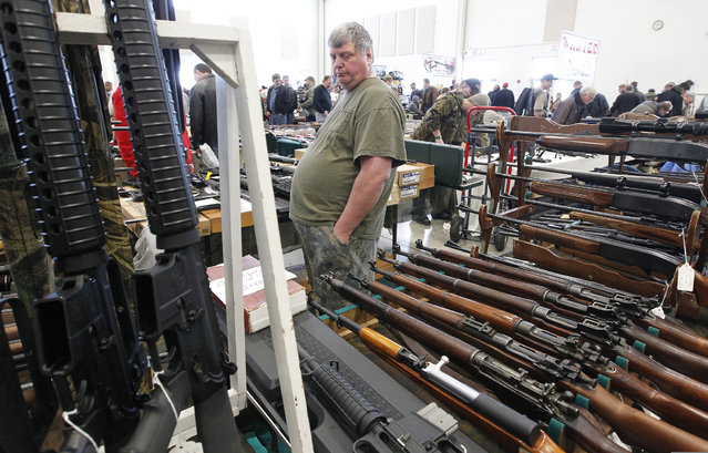 A man who asked that his name not be used watches over his inventory at the Washington County Fairgrounds Gun Show that drew thousands of people over the weekend, on March 22, 2013. (Photo by Gary Porter)