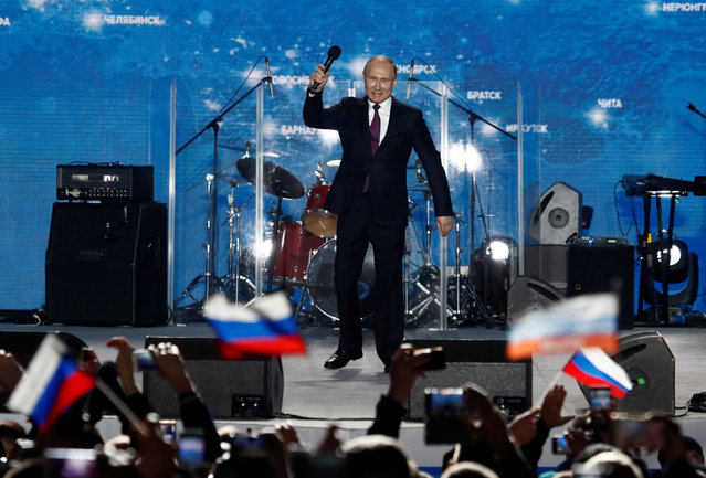 Russian president Vladimir Putin addresses the audience during a rally marking the fourth anniversary of Russia's annexation of Ukraine's Crimea region in the Black Sea port of Sevastopol, Crimea, March 14, 2018. (Photo by Maxim Shemetov/Reuters)
