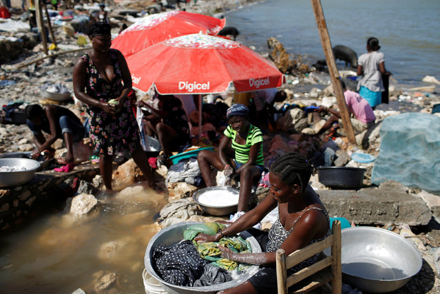 Women do laundry after Hurricane Matthew passes in Jeremie, Haiti, October 8, 2016. (Photo by Carlos Garcia Rawlins/Reuters)
