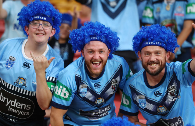 Blues fans cheer before game three of the State of Origin series between the Queensland Maroons and the New South Wales Blues at Suncorp Stadium on November 18, 2020 in Brisbane, Australia. (Photo by Chris Hyde/Getty Images)