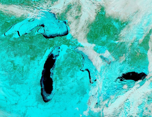 A false-colored image of the frozen Great Lakes is seen in this February 19, 2014 handout taken by the Moderate Resolution Imaging Spectroradiometer (MODIS) aboard NASA's Aqua satellite. (Photo by Reuters/NASA)