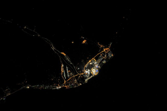 Sochi Olympic Park at night from space, as seen from the ISS (International Space Station) taken by an Expedition 38 crew member on February 10, 2014 above Sochi, Russia. The bright circular structure near lower centre is Fisht Stadium where the opening ceremonies for the Winter Olympics were held on 7 February 2014, and where the Olympic Cauldron holds the Olympic Flame. (Photo by NASA/SPL/Barcroft Media)