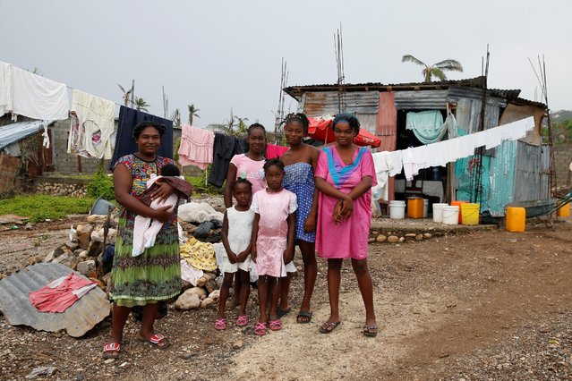 Marie Lestin (L), 34, poses for a photo next to her children in front of their new house after Hurricane Matthew hit Jeremie, Haiti, October 20, 2016. (Photo by Carlos Garcia Rawlins/Reuters)