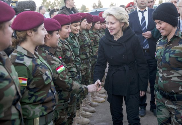 German Defence Minister Ursula von der Leyen (2nd R) greets Kurdish forces female recruits at the Zeravani Training Centre in Bnaslava near Arbil, north of Iraq January 12, 2015, who are being trained by the German armed forces, Bundeswehr. (Photo by Maurizio Gambarini/Reuters)
