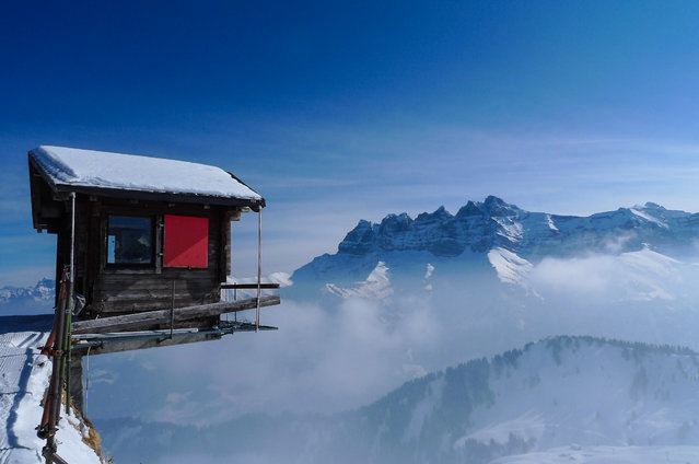 """""""Living on the Edge"""". It was a Saturday in February 2012. I took this photo at the top of the chairlift of the Pointe de l'Au in the ski area of Les Portes du Soleil, Switzerland. In the background, the Les Dents du Midi.  (Photo and caption by Florin Biscu/National Geographic Traveler Photo Contest)"""