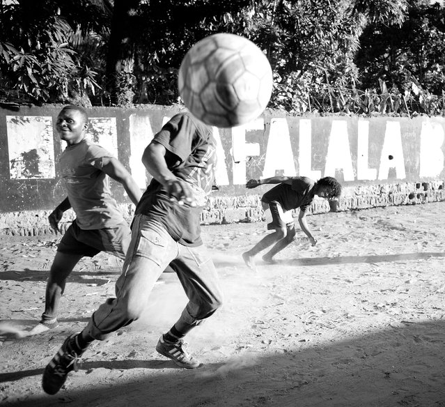 """Football @ Mafalala"". This is a shoot of a little group playing soccer at one of the poorest areas of Maputo. Location: Mafalala, maputo, Mozambique. (Photo and caption by Pablo Caruncho/National Geographic Traveler Photo Contest)"
