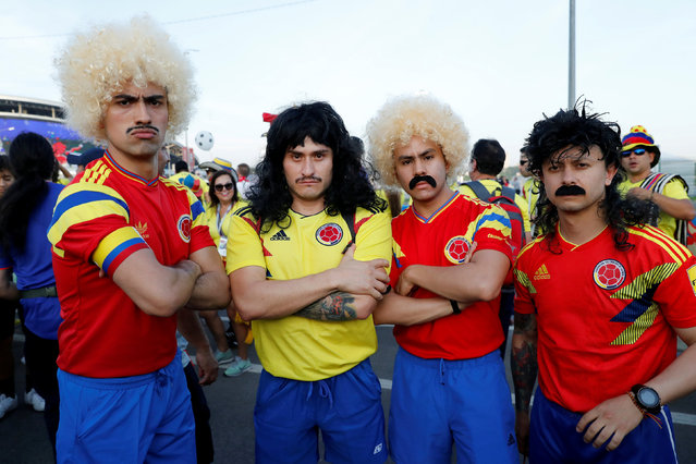Colombia fans wearing wigs outside the stadium before the Russia 2018 World Cup Group H football match between Poland and Colombia at the Kazan Arena in Kazan on June 24, 2018. (Photo by Jorge Silva/Reuters)