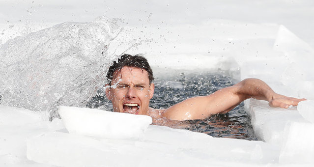 Freediver David Vencl reacts after setting a new world record in men's swimming under ice near Teplice, Czech Republic, Tuesday, February 23, 2021. Vencl swam the longest distance of 80.9 meters (265 ft) on Tuesday with breath held only in his swimsuit and swim goggles. In this category, freedivers cannot use any fin, diving suit, cap and weights. (Photo by Petr David Josek/AP Photo)