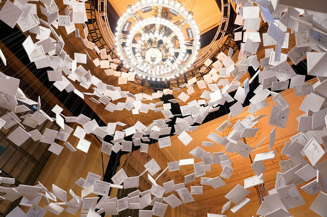 """Diplomas are part of artwork, entitled """"Da Vinci of Debt"""", on display at Grand Central Terminal on January 16, 2022, in New York. The artwork is made up of 2,600 authentic college diplomas from real graduates across the country. The exhibit, put on by Natural Light Beer, was created to represent the average total cost of a four-year college education, $180,000, resulting, with the total diplomas, in a art piece worth $468 million. (Photo by Timothy A. Clary/AFP Photo)"""