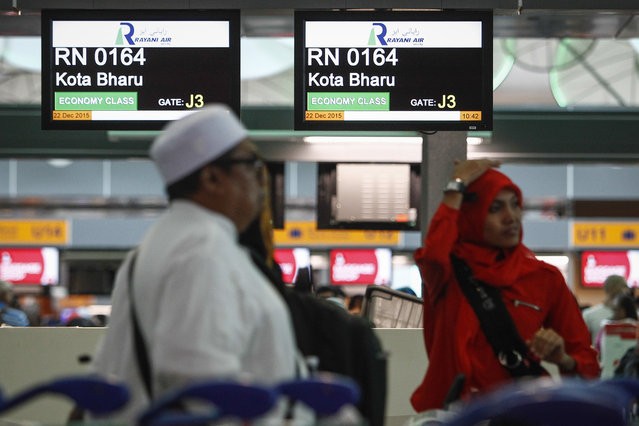 In this December 22, 2015, photo, Muslim travellers queue up in front of Rayani Air's check-in counter at Kuala Lumpur International Airport 2 in Sepang, Malaysia. (Photo by Joshua Paul/AP Photo)
