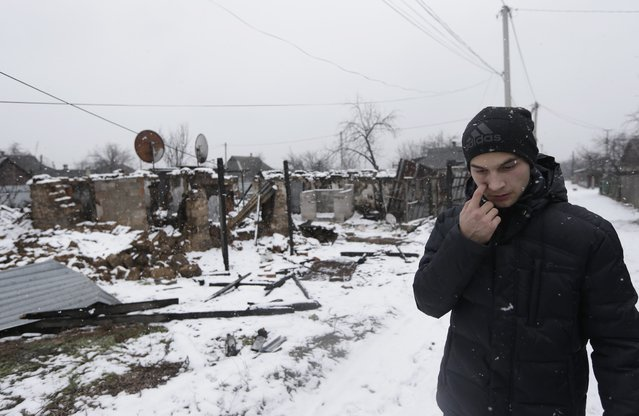In this picture taken, Monday, February 9, 2015, Ruslan Banin, 18 years old, walks in his neighborhood  in Donetsk, Ukraine. (Photo by Petr David Josek/AP Photo)